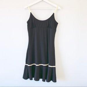 Anthropologie Eloise black slip dress ruffle trim